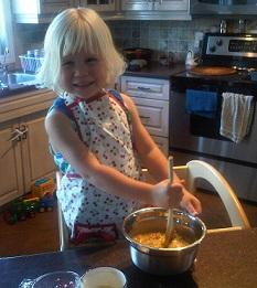 child helping to bake