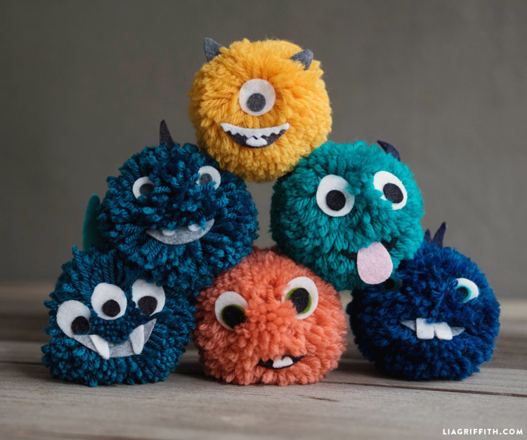 DIY yarn pom pom monsters