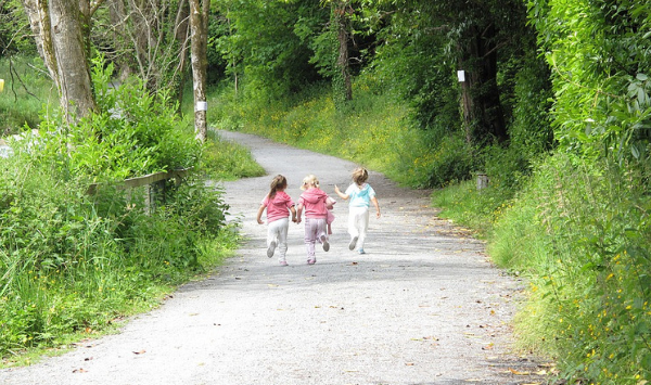 3 young children running outside