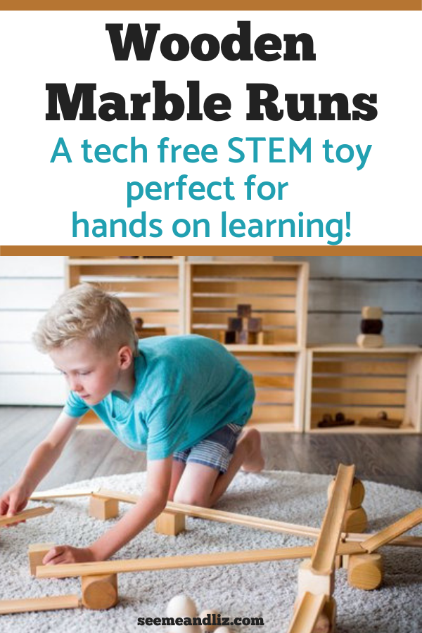 Boy playing with wood marble run set with text overlay