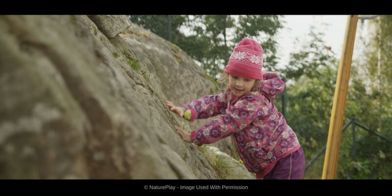 nature play documentary young child exploring large rock formation