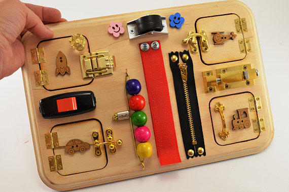 Toddler busy board great for car and plane rides!