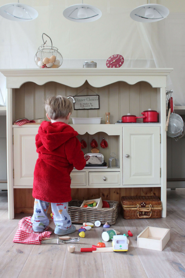Make your own kids play kitchen with the top of a dresser! All you need is some paint and a few accessories